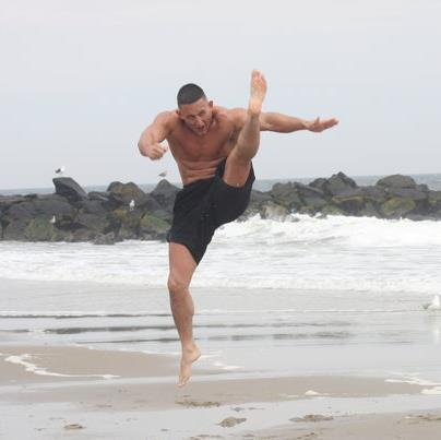 Anthony L. Gonzalez displaying the jumping crane kick.